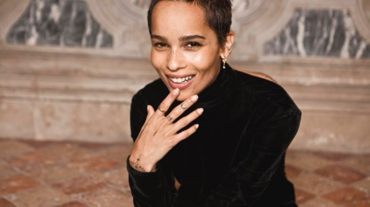 Flashing a smile, Zoe Kravitz poses in Saint Laurent dress