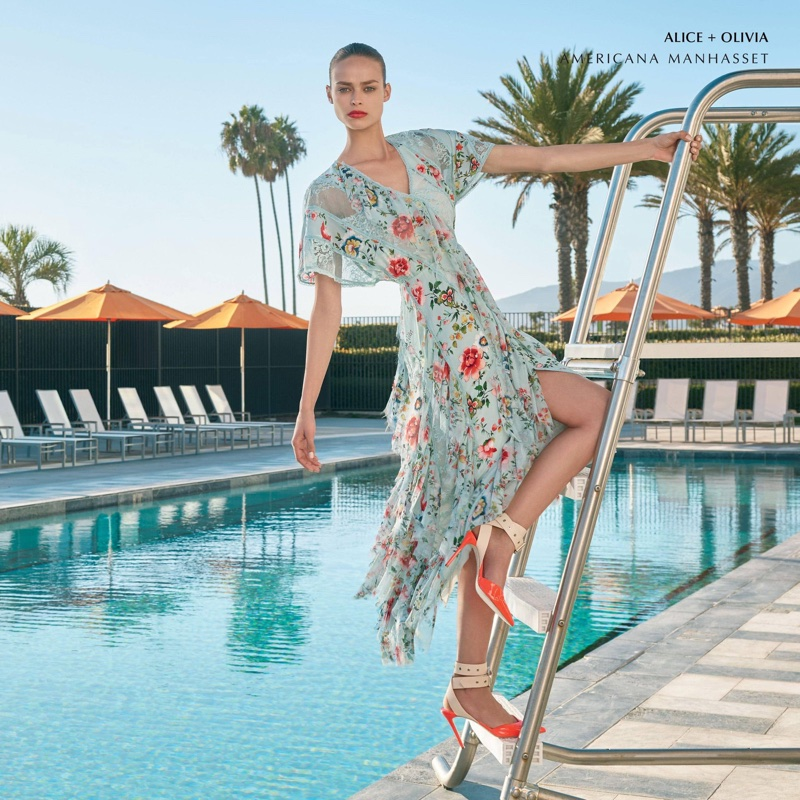 Posing by the pool, Birgit Kos wears Alice + Olivia dress in Americana Manhasset spring 2018 campaign