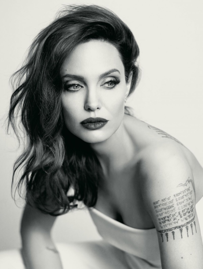 Photographed in black and white, Angelina Jolie wears her hair in glamorous waves. Photo: Mathieu Cesar