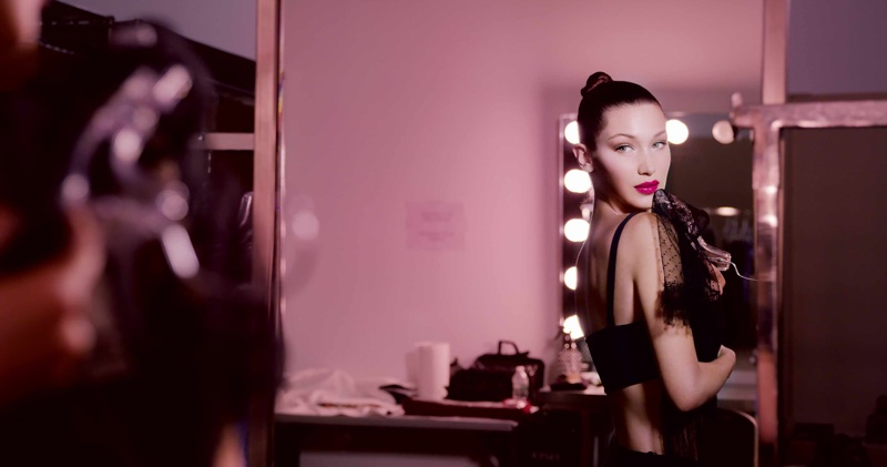 Model Bella Hadid poses behind-the-scenes for Dior Addict Lacquer Plump campaign
