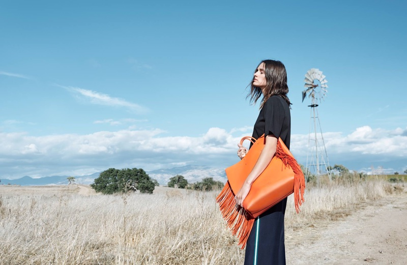 Leila Goldkuhl poses with orange bag in CK Calvin Klein's spring-summer 2018 campaign