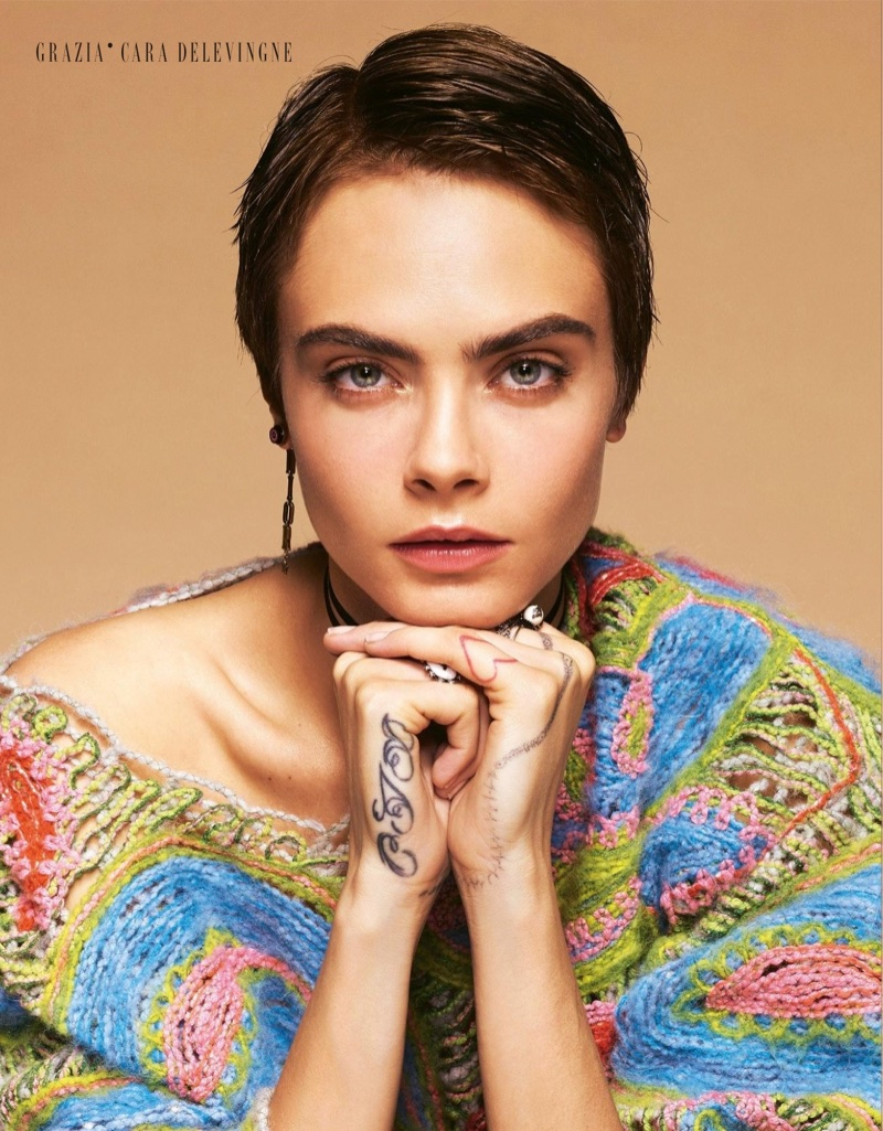 Model Cara Delevingne shows off a brown pixie haircut