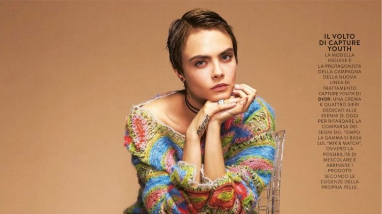 Cara Delevingne wears Dior sweater, skirt and boots
