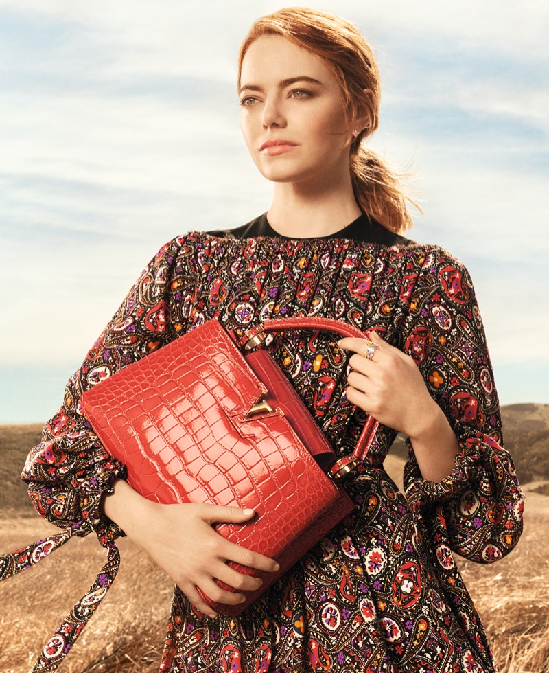 Actress Emma Stone poses with Capucines bag in Louis Vuitton Spirit of Travel campaign