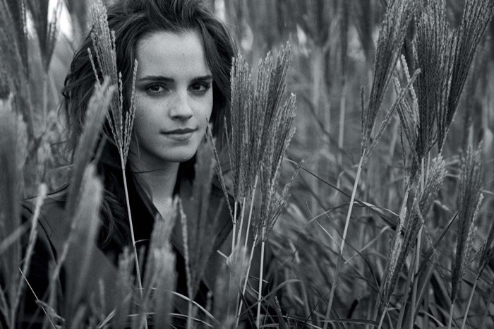 Posing outdoors, Emma Watson wears Kwaidan Editions coat