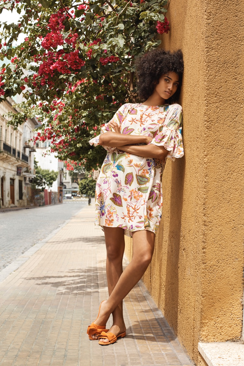 Imaan Hammam poses in printed dress for H&M's spring 2018 campaign