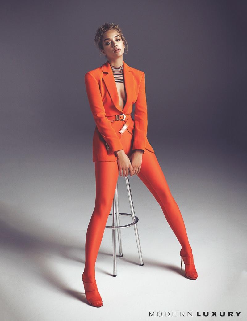 Suiting up, Jasmine Sanders poses in Versace blazer, belt, leggings and sandals