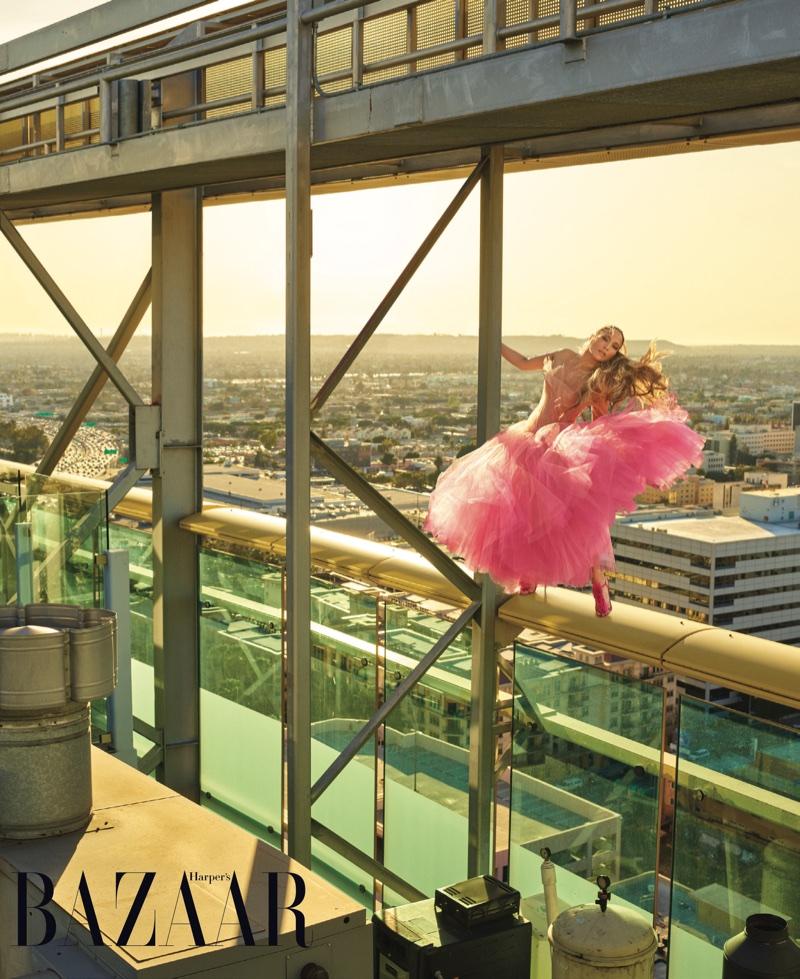 Looking pretty in pink, Jennifer Lopez wears Oscar de la Renta gown and Manolo Blahnik sandals