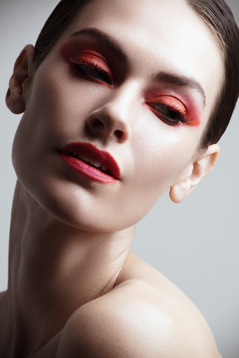 Model Kate Herman wears red eyeshadow with matching lip color. Photo: Jeff Tse