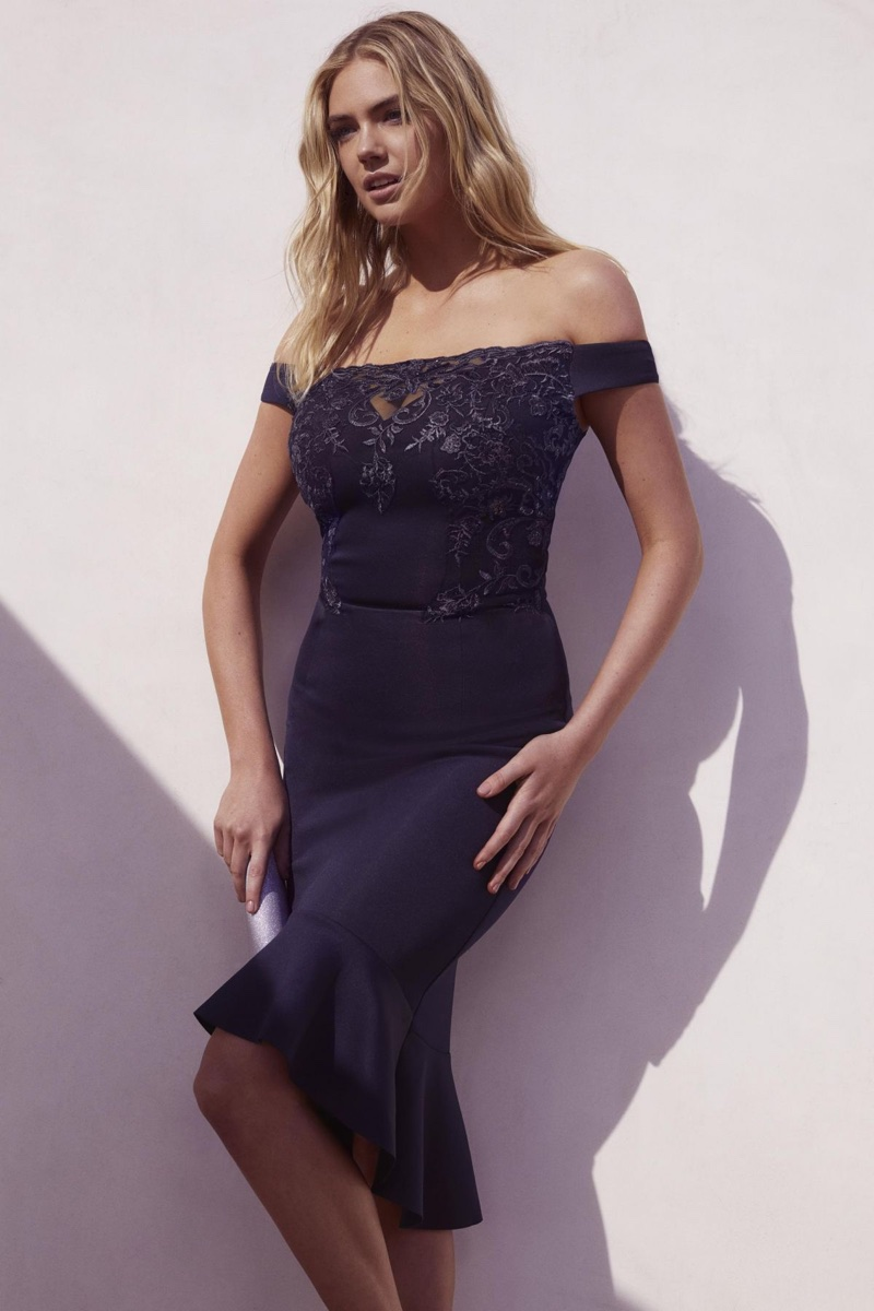 Kate Upton poses in a little black dress for Lipsy's summer 2018 campaign