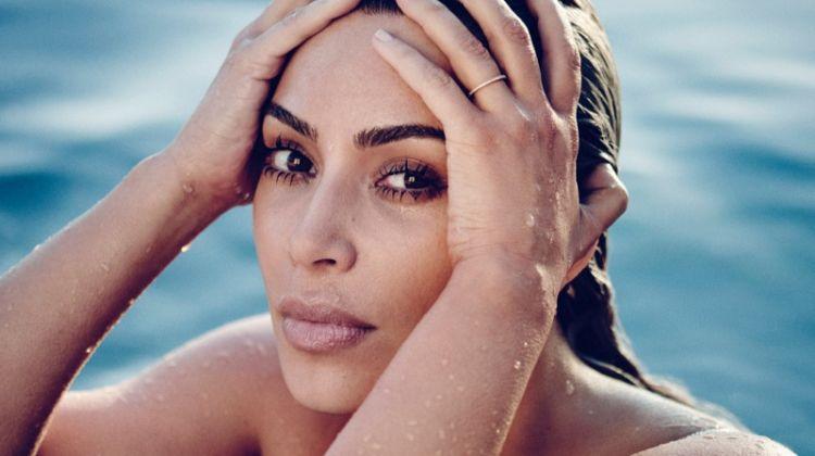 Posing in a pool, Kim Kardashian poses for ELLE