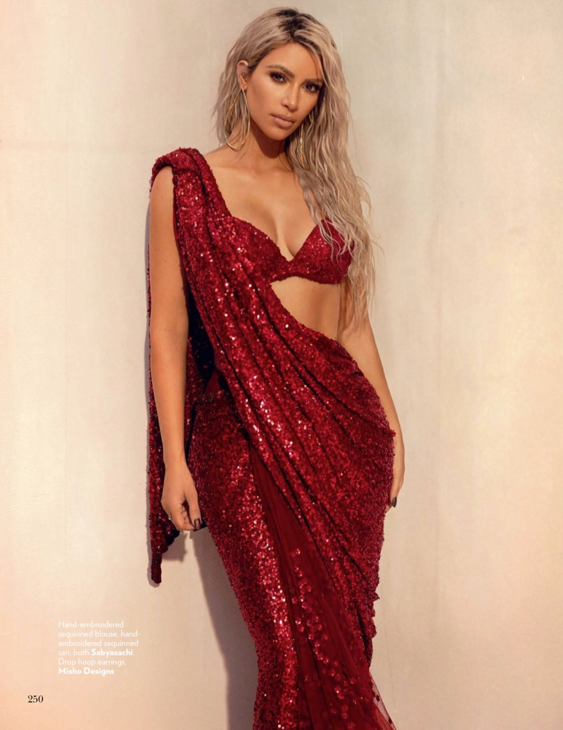 Kim Kardashian poses in Sabyasachi sequined blouse and sari with Misho Designs hoop earrings