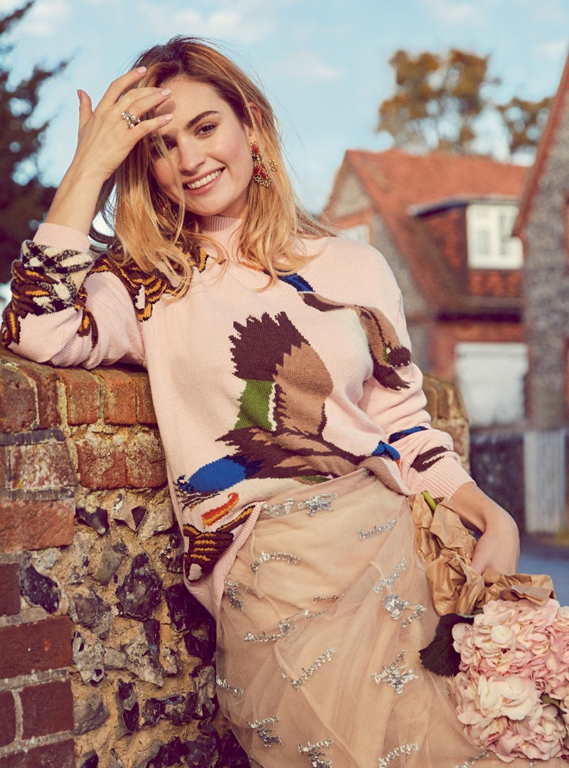 Actress Lily James poses in Burberry sweater and tulle skirt
