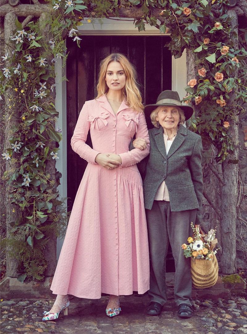 Looking pretty in pink, Lily James wears Emilia Wickstead coat dress and Salvatore Ferragamo heels