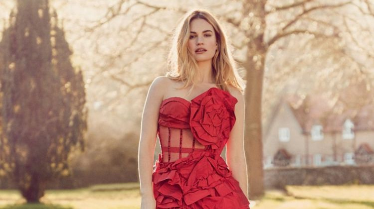 Posing with dogs, Lily James wears red Alexander McQueen corset dress and skirt