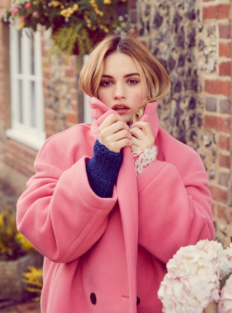 Lily James poses in Burberry wool coat and sweater