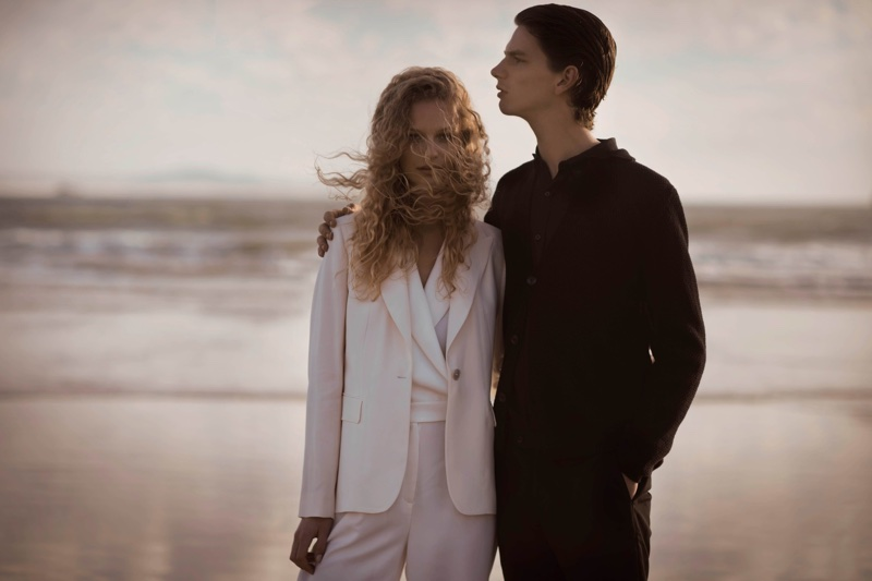 Posing on the beach, Frederikke Sofie and Erik van Gils front Massimo Dutti lookbook