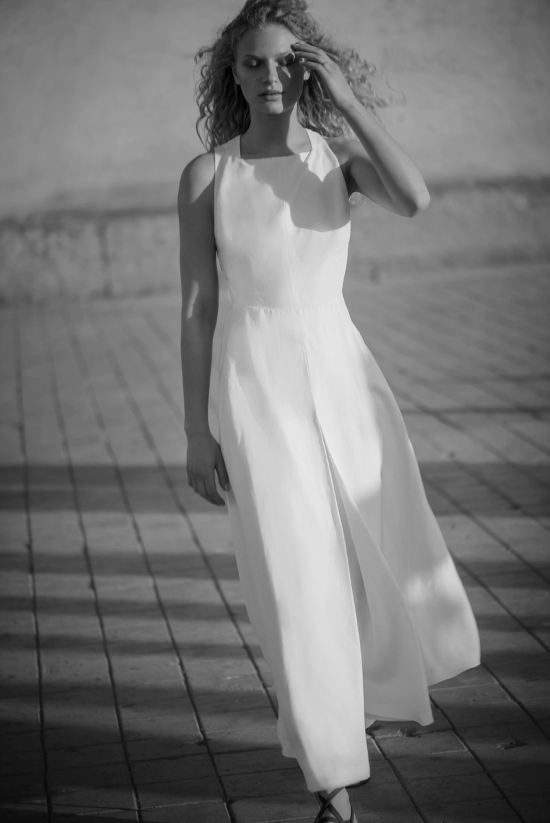 Model Frederikke Sofie wears white dress for Massimo Dutti 'Les Voyageurs' lookbook