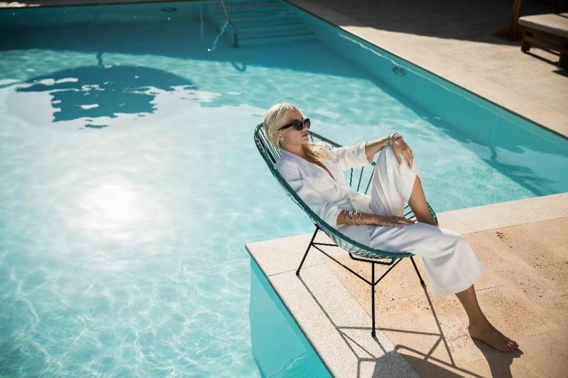 Posing poolside, Pixie Lott wears white pantsuit