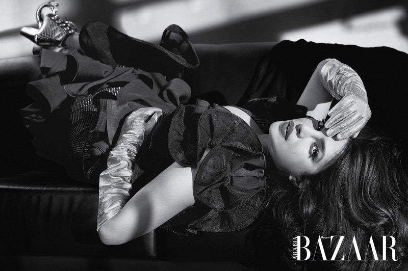 Photographed in black and white, Priyanka Chopra wears Balmain top, skirt and boots with LaCrasia gloves