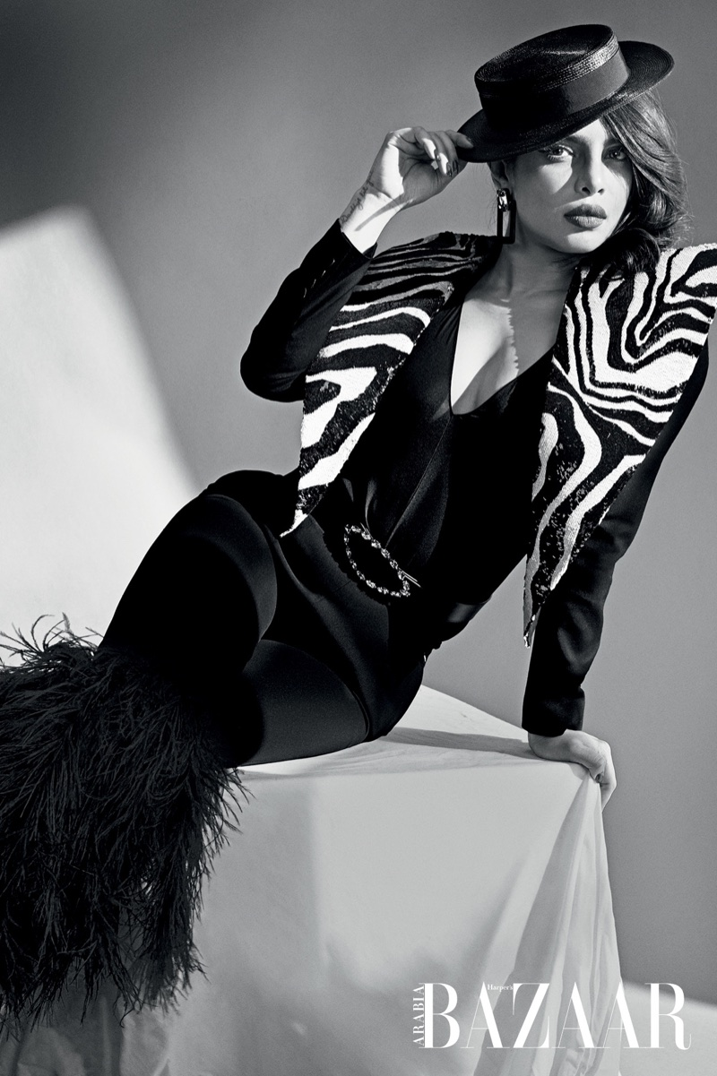 Priyanka Chopra poses in Saint Laurent blazer, pants, boots, belts, earrings and hat