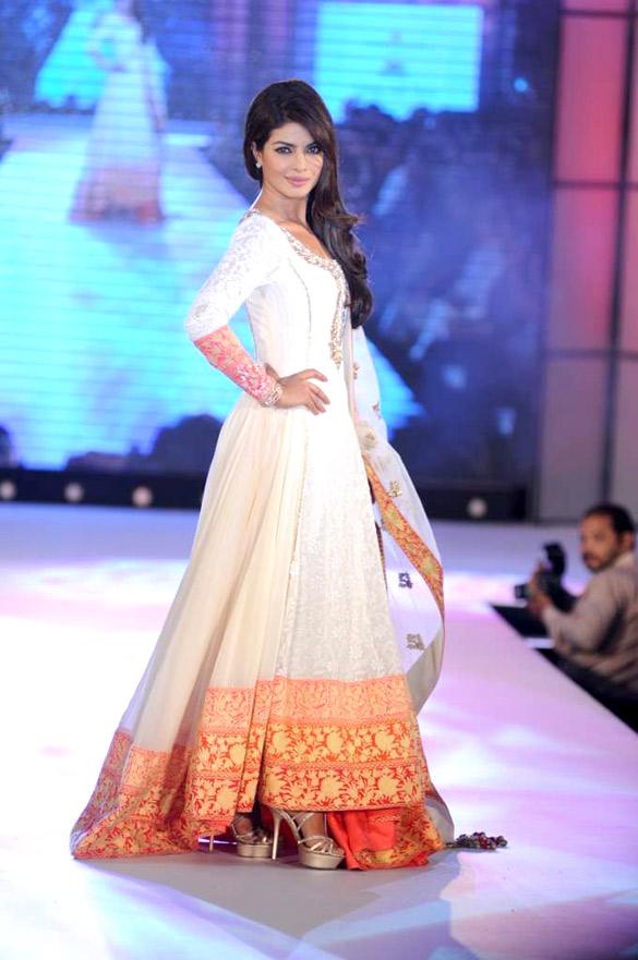 1f1aecc1f2 Priyanka Chopra wears an Indian Anarkali dress as she walks for Manish  Malhotra & Shaina NC