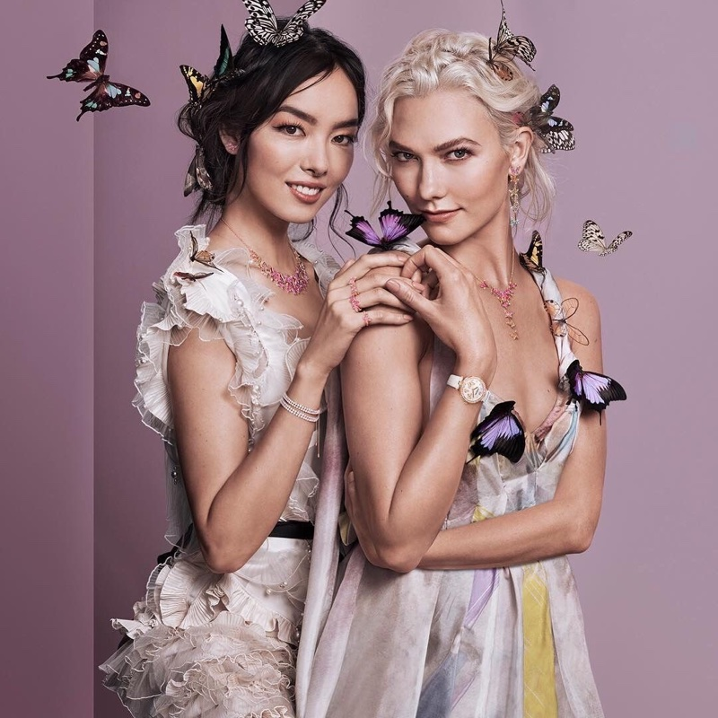 Fei Fei Sun and Karlie Kloss pose with butterflies for Swarovski's spring 2018 campaign