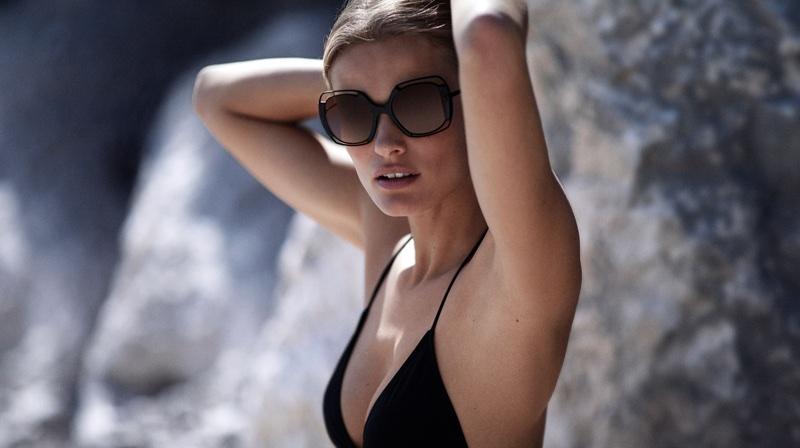 Edita Vilkeviciute models black bikini in Tory Burch's resort 2018 campaign