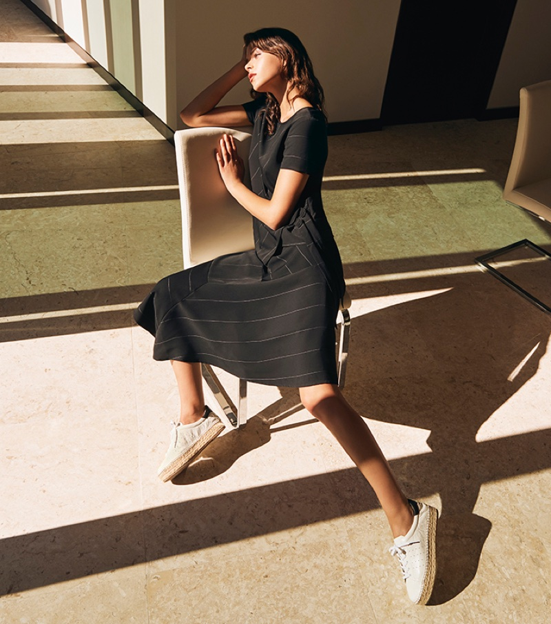 Model Georgia Fowler wears black dress in Vince Camuto's spring-summer 2018 campaign