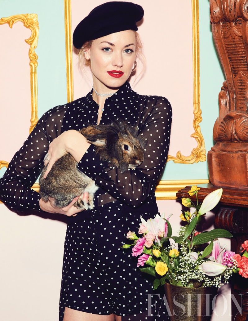 Posing with a rabbit, Yvonne Strahovski wears Dior polka dot jumpsuit and skirt with Topshop hat