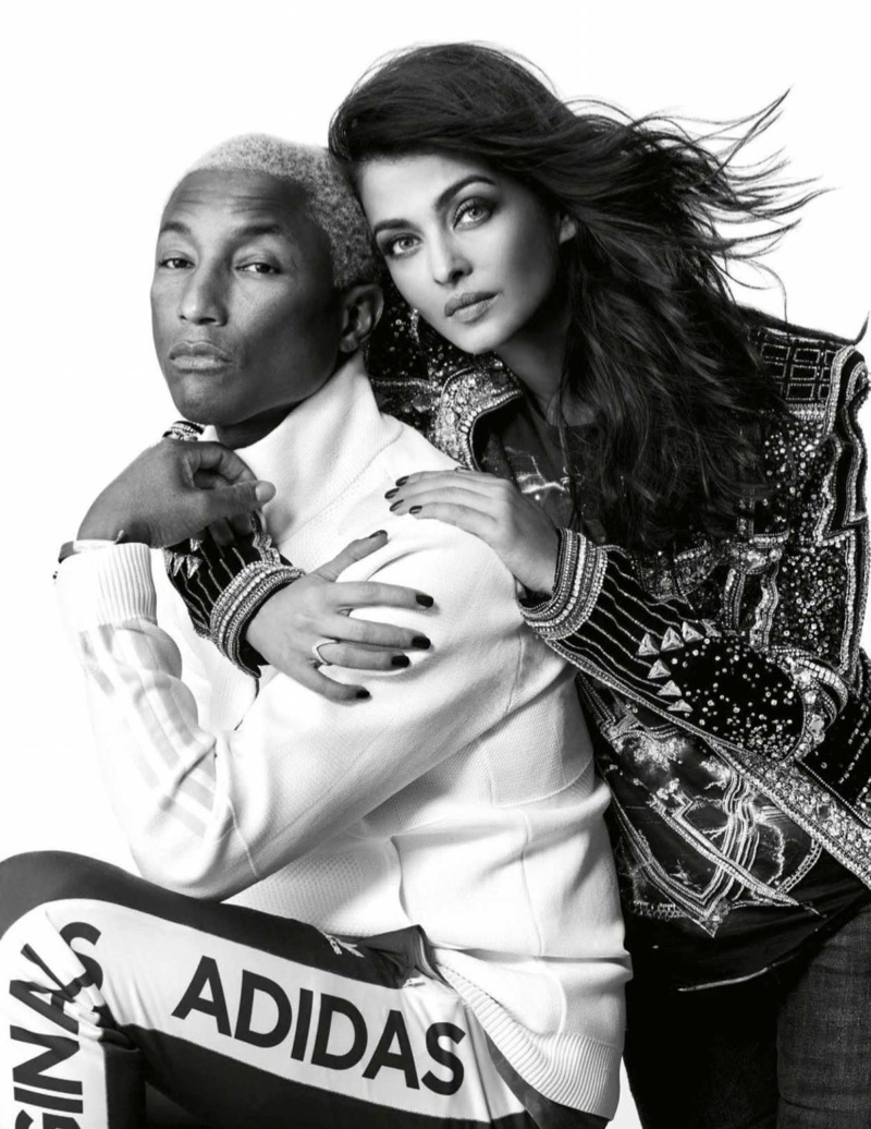 Photographed in black and white, Aishwarya Rai wears Balmain t-shirt and jacket with Zara jeans alongside Pharrell Williams