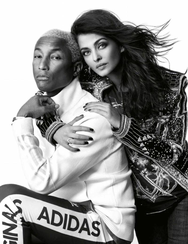 Photographed in black and white, Aishwarya Rai wears Balmain t-shirt and jacket with Zara jeans alongside Pharrell Williams