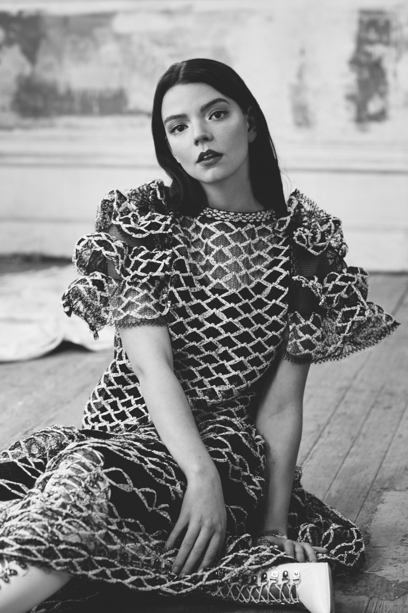 Photographed in black and white, Anya Taylor-Joy wears Chanel dress