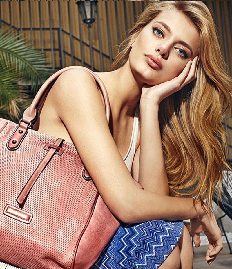 Posing with a pink bag, Bregje Heinen appears in Refresh Shoes' spring-summer 2018 campaign