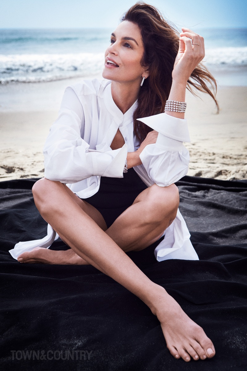 Supermodel Cindy Crawford poses in Oscar de la Renta shirt, Valentino swimsuit and Van Cleef & Arpels jewelry