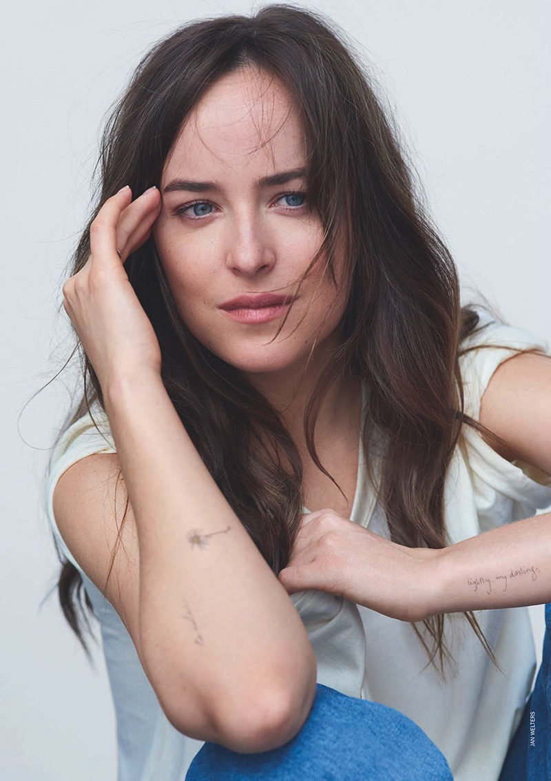 Actress Dakota Johnson shows off her arm tattoos