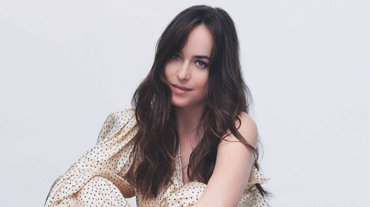 Dakota Johnson poses in Gucci top and pants