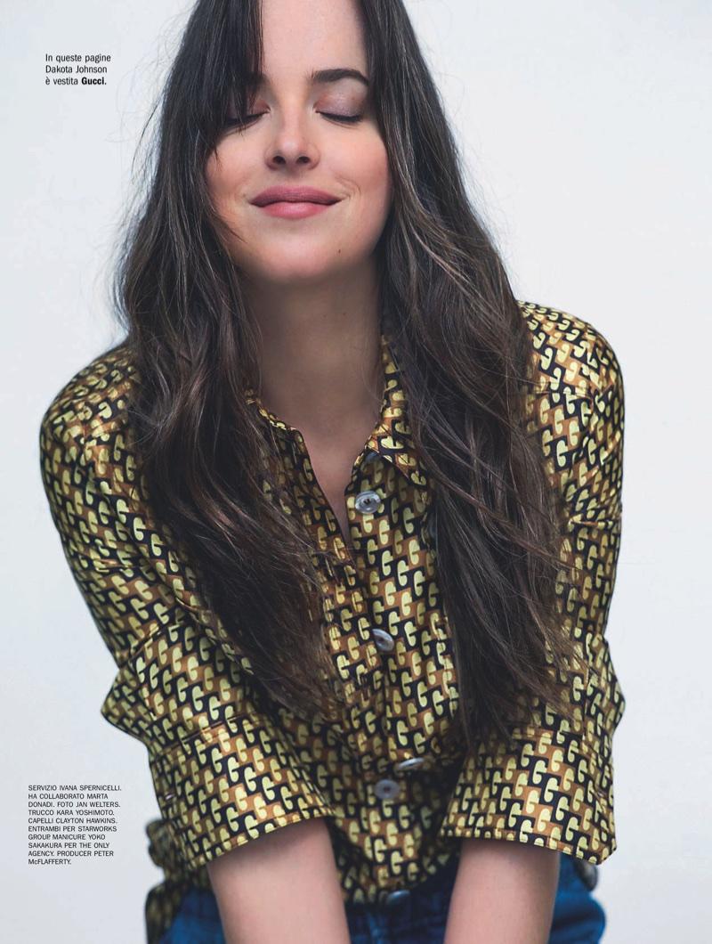 Dakota Johnson poses in Gucci blouse