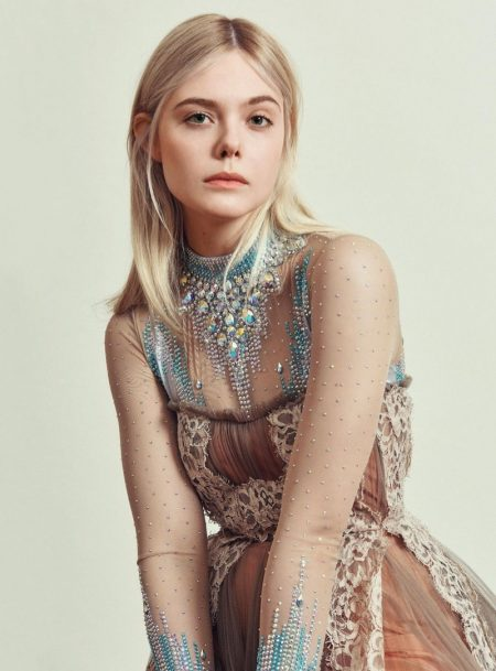 Actress Elle Fanning wears embellished bodysuit and lace dress from Gucci
