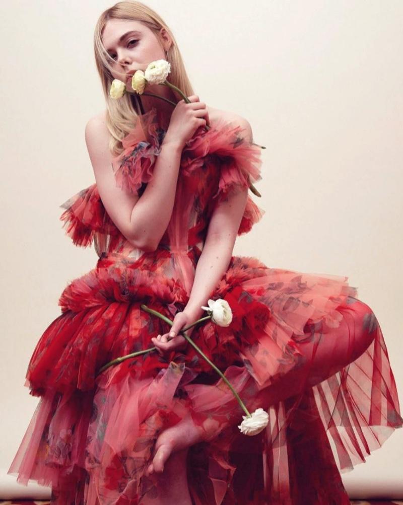 Dressed in red, Elle Fanning wears Alexander McQueen gown