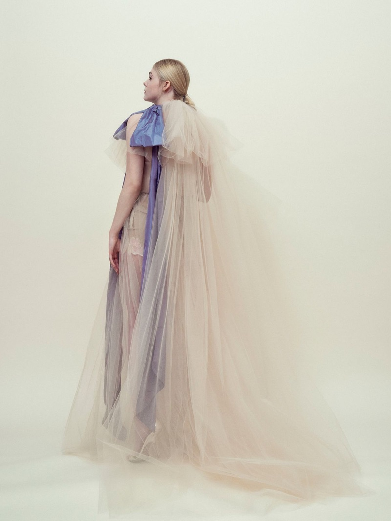 Actress Elle Fanning wears a tulle gown from Valentino Haute Couture