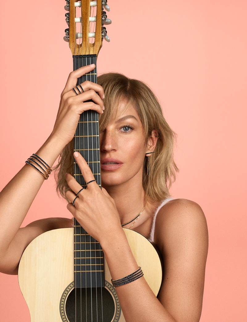 Posing with a guitar, Gisele Bundchen fronts Vivara Bossa Nova campaign