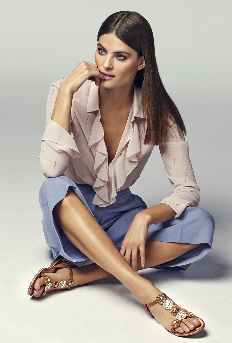 Model Isabeli Fontana wears sandals in Carmela Shoes' spring-summer 2018 campaign