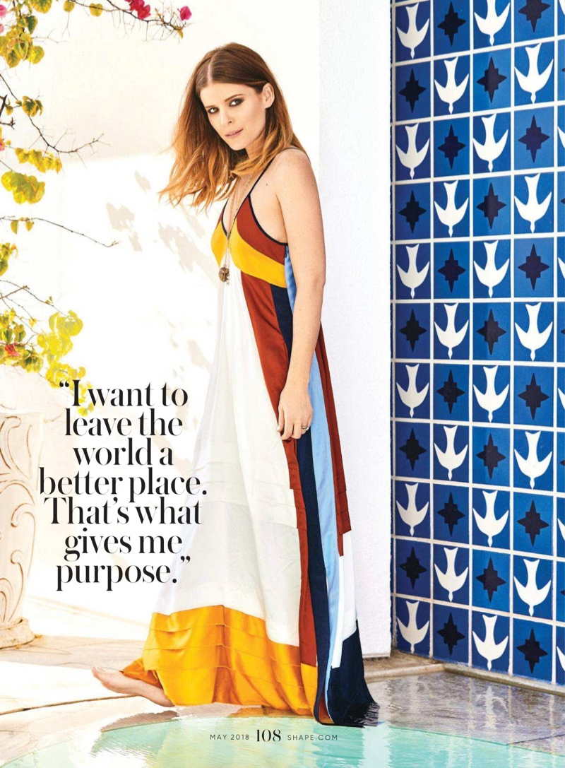 Posing by the pool, Kate Mara wears Tory Burch maxi dress and necklace