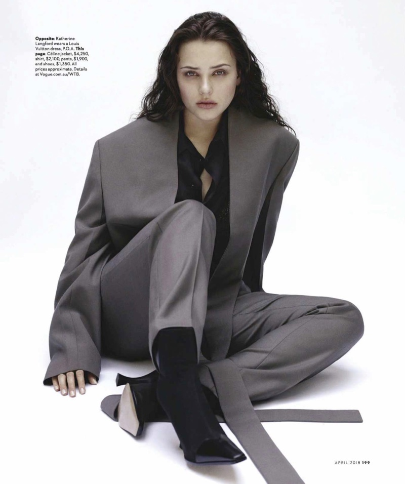Suiting up, Katherine Langford poses in a Celine pantsuit and heels