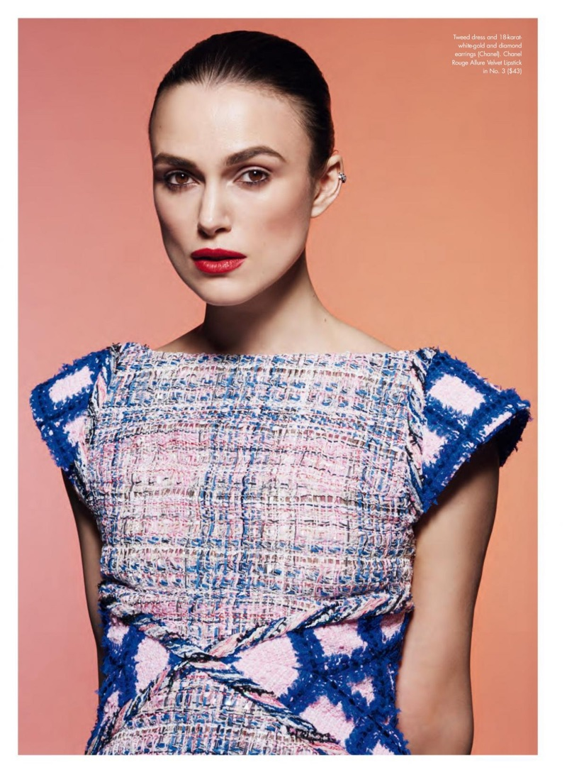 Actress Keira Knightley poses in Chanel tweed dress and earrings
