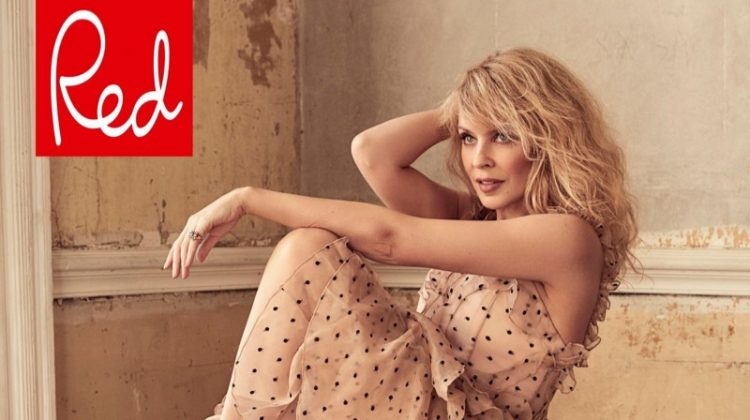 Singer Kylie Minogue poses in polka dot print dress