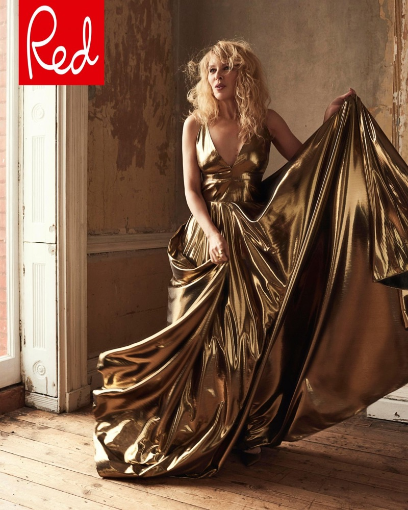 Wearing a gold gown, Kylie Minogue shines in this shot