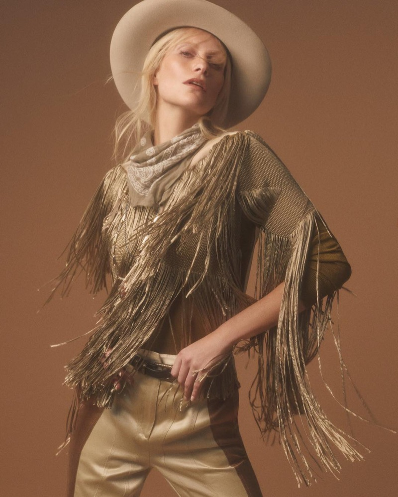 Embracing fringe, Poppy Delevingne poses in Bottega Veneta look