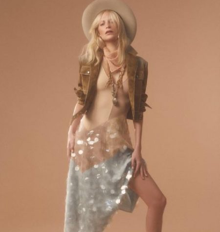 Poppy Delevingne poses in Bottega Veneta jacket and dress